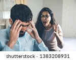 angry woman with sad man in home | Shutterstock . vector #1383208931