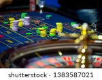 Roulette table with human hands ...