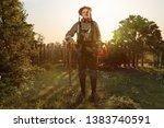 gardener stands in his unkempt... | Shutterstock . vector #1383740591