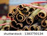cinnamon sticks in spice store... | Shutterstock . vector #1383750134