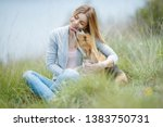 woman walking with a dog in... | Shutterstock . vector #1383750731