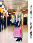 happy girl with shopping bags... | Shutterstock . vector #138380657