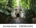Orcus mouth sculpture at famous Parco dei Mostri (Park of the Monsters), also named Sacro Bosco (Sacred Grove) or Gardens of Bomarzo in Bomarzo, province of Viterbo, northern Lazio, Italy - stock photo