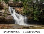 Cedar falls, a beautiful waterfall in the Hocking Hills of Ohio, flows strongly after heavy spring rains.