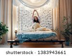 young happy woman stretching in ... | Shutterstock . vector #1383943661