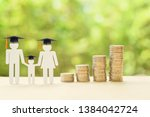 Small photo of Saving money for kid, child education concept : Family members wear graduation cap or hat, 4 rows of rising coins, depicts increasing in cost or expense for paying tuition fee when study higher class