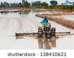 thai farmer plowing his farm... | Shutterstock . vector #138410621