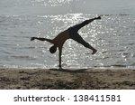somersaulting on beach | Shutterstock . vector #138411581