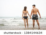 happy young asian couple man... | Shutterstock . vector #1384144634