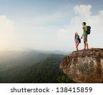 two hikers standing on top of a ... | Shutterstock . vector #138415859