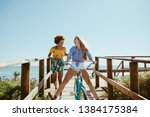 young woman riding bike on... | Shutterstock . vector #1384175384