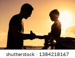 silhouette of loving father... | Shutterstock . vector #1384218167