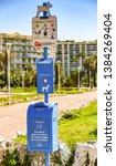 Small photo of CANNES, FRANCE - APRIL 2019: Notice on the promenade in Cannes for dog owners to use bags to clean up after their dogs and place in the waste bine