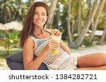 happy girl is drinking fruit...   Shutterstock . vector #1384282721