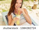 happy girl is drinking fruit...   Shutterstock . vector #1384282724