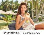 happy girl is drinking fruit...   Shutterstock . vector #1384282727