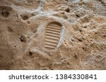 Stock photo footprint on the moon surface 1384330841