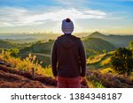 young man on the top of the... | Shutterstock . vector #1384348187