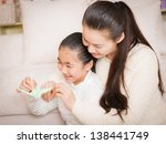 mother and daughter with the... | Shutterstock . vector #138441749