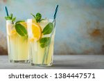 two glass with lemonade or... | Shutterstock . vector #1384447571