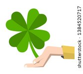 lucky clover leaf in human hand ... | Shutterstock .eps vector #1384520717