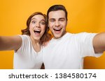 excited beautiful couple... | Shutterstock . vector #1384580174