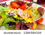 delicious tuna salad with mixed ... | Shutterstock . vector #1384584104