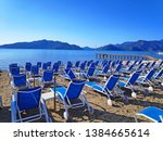 view of sunbeds on the beach in ... | Shutterstock . vector #1384665614