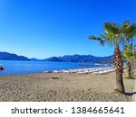 view of sunbeds on the beach in ... | Shutterstock . vector #1384665641