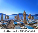 view of sunbeds on the beach in ... | Shutterstock . vector #1384665644