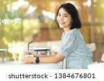 asian young woman sitting in... | Shutterstock . vector #1384676801