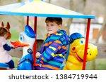 Adorable Kid Boy Riding On...