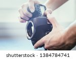 hands of a photographer are... | Shutterstock . vector #1384784741