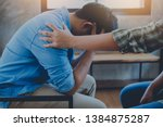 Small photo of A Christian young man praying for his friends while sitting on wooden chair at church prayer room to encourage and support him in his problem and spiritual growth.