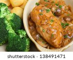 Chicken chasseur, classic French dish cooked with mushrooms and white wine. - stock photo