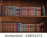 Library shelves full of old books - stock photo