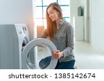 happy housewife engaged in... | Shutterstock . vector #1385142674