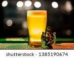 golden ale beer pint with irish ... | Shutterstock . vector #1385190674
