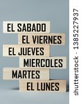 Small photo of A list of wooden blocks lying on top of each other with a list of six-day working week days in Spanish, in the translation of the word: saturday, friday, thursday, wednesday, tuesday, monday