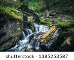 stony well in colorful green... | Shutterstock . vector #1385253587