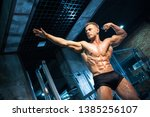handsome athlete with perfect... | Shutterstock . vector #1385256107