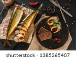 Stock photo sandwich with smoked mackerel fish with spices on dark stone background smoked fish mediterranean 1385265407