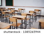 Small photo of School empty classroom or lecture room interior with desks chair iron wooden whiteboard for studying lessons of secondary education in high school thailand. Learning and Back to school concept