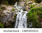 fudo waterfall in the forest at ... | Shutterstock . vector #1385301011