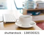 coffee cup on the table with... | Shutterstock . vector #138530321
