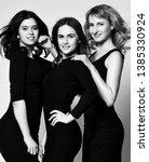 three business woman in black... | Shutterstock . vector #1385330924