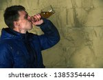 a disheveled man with alcohol...   Shutterstock . vector #1385354444