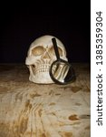 skull and magnifier on old... | Shutterstock . vector #1385359304