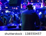 Stock photo dj turns the records at the club under the blue light 138550457
