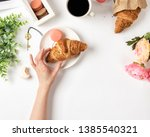 Woman's Hand Holding Croissant. ...